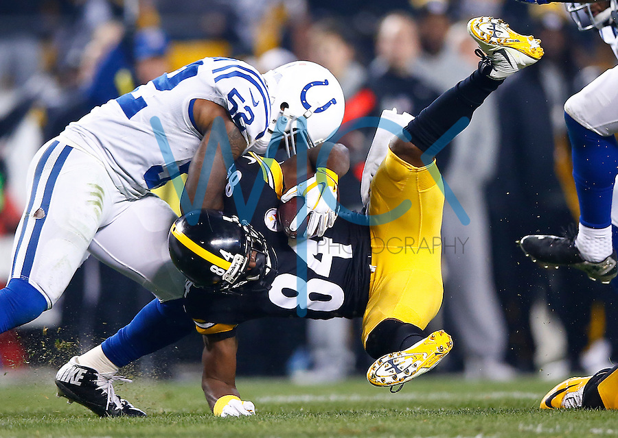 Antonio Brown #84 of the Pittsburgh Steelers is tackled by D'Qwell Jackson #52 of the Indianapolis Colts after catching a pass in the first half during the game at Heinz Field on December 6, 2015 in Pittsburgh, Pennsylvania. (Photo by Jared Wickerham/DKPittsburghSports)