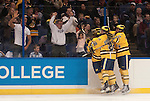 March 26,  2011                      Teammates congratulate Michigan forward Scooter Vaughan (3) after the first goal of the period, at the 2:23 mark. The University of Michigan was leading Colorado College 2-0 after the first period in the championship game of the NCAA Division 1 Men's West Regional Hockey Tournament, on Saturday March 26, 2011 at the Scottrade Center in downtown St. Louis.