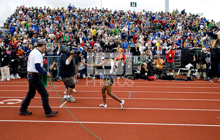 EUGENE, OR--Gelete Burka celebrates her 1500 meter win during the Steve Prefontaine Classic, Hayward Field, Eugene, OR. SUNDAY, JUNE 10, 2007. PHOTO © 2007 DON FERIA