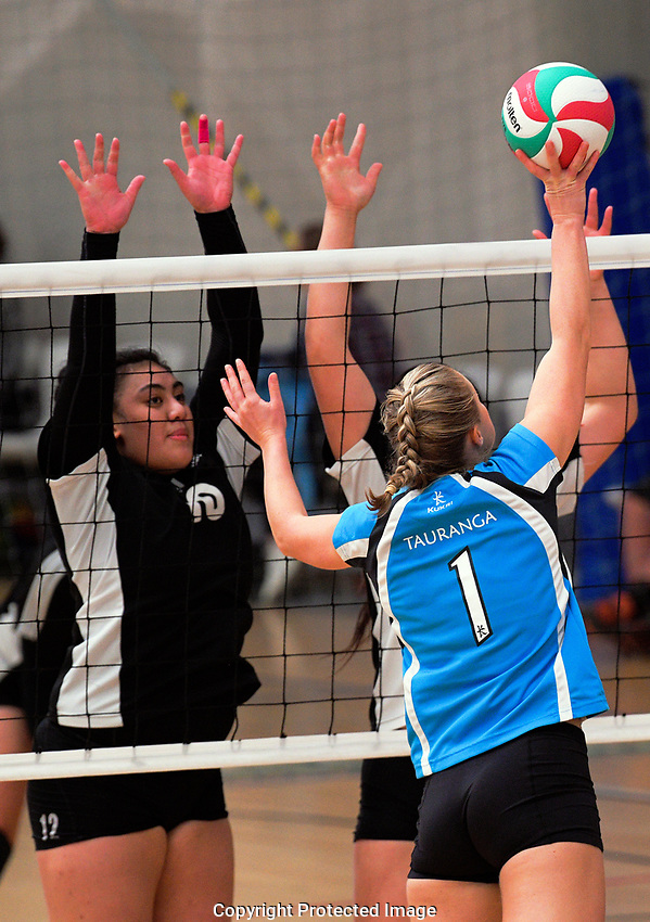 Action from the Volleyball NZ 50th National Club Championship women's division one match between Tauranga (sky blue) and Hawks at ASB Sports Centre in Wellington, New Zealand on Saturday, 12 October 2017. Photo: Dave Lintott / lintottphoto.co.nz