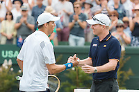 March 5, 2016: Jim Courier, captain of the US team congratulates Mike Bryan after winning the doubles match against Lleyton Hewitt and John Peers of Australia at the BNP Paribas Davis Cup World Group first round tie between Australia and USA at Kooyong tennis club in Melbourne, Australia. Photo Sydney Low