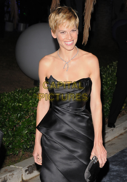 HILARY SWANK .Attending The Nakheel Introduction of The Trump International Hotel & Tower Dubai held at The Tar Estate in Bel Air, California on August 23rd 2008.                                                                     .half length black strapless dress Vivvienne Westwood silk satin .CAP/DVS.©Debbie VanStory/Capital Pictures