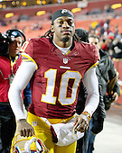 Washington Redskins quarterback Robert Griffin III (10) leaves the field after he led his team to a 27 - 24 victory over the Philadelphia Eagles at FedEx Field in Landover, Maryland on Saturday, December 20, 2014.  <br /> Credit: Ron Sachs / CNP
