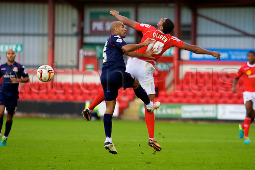 14.09.2013 Crewe, England. Walsall FC defender Dean Holden and Crewe Alexandra forward Vadaine Oliver in action during the League One game between Crewe Alexandra and Walsall FC from the Alexandra Stadium