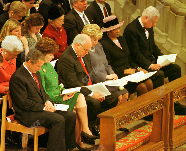 President Bush prays with his wife Laura, Vice President Dick Cheney and his wife Lynne during a morning church service at the National Cathedral. Washington, D.C., USA, January 21, 2001.