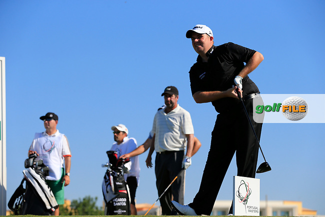 Shane Lowry (IRL) tees off the 1st tee during Thursday's Round 1 of the 2013 Portugal Masters held at the Oceanico Victoria Golf Club. 10th October 2013.<br /> Picture: Eoin Clarke www.golffile.ie