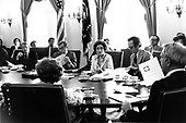 "United States President Jimmy Carter, left, and US Secretary of Energy James R. Schlesinger, far right with back to the camera, discuss the CIA report on the international energy situation at a cabinet meeting in the Cabinet Room of the White House in Washington, DC on April 18, 1977.  The President is scheduled to deliver energy address to the nation on live television in the evening.  In his remarks, the President will equate the energy crisis as the ""moral equivalent of war.""  From left to right: President Carter, US Secretary of Defense Harold Brown, US Secretary of Commerce Juanita M. Kreps, US Secretary of Labor F. Ray Marshall, Secretary Schlesinger.<br /> Credit: White House via CNP"
