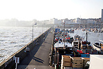 Contre-jour picture of harbour wall and rough sea, Bridlington, Yorkshire, England
