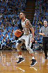 Mitchell Wilbekin (10) of the Wake Forest Demon Deacons runs the offense during first half action against the North Carolina Tar Heels at the Dean Smith Center on December 30, 2017 in Chapel Hill, North Carolina.  The Tar Heels defeated the Demon Deacons 73-69.  (Brian Westerholt/Sports On Film)