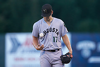 Augusta GreenJackets starting pitcher Blake Rivera (17) flips the ball as he stands on the mound during the game against the Kannapolis Intimidators at Kannapolis Intimidators Stadium on June 21, 2019 in Kannapolis, North Carolina. The Intimidators defeated the GreenJackets 6-1. (Brian Westerholt/Four Seam Images)