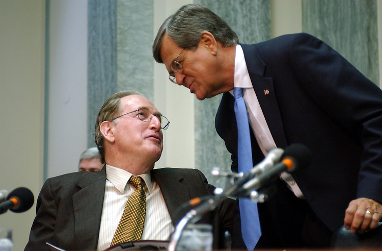 hutchinson1_012203 -- John D. Rockefeller, D-W.Va., and Trent Lott, R-Miss., talk during the full committee hearing on the nomination of Asa Hutchinson to be undersecretary for Border and Transportationc of the Homeland Security Department.