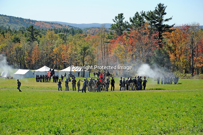 Civil War Reenactment Confederate Army and Union Army Soldiers on Battlefield
