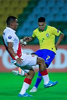 ARMENIA, COLOMBIA - JANUARY 19: Brazil's Paulinho shoots the ball as Peru's Eduardo Rabanal tries to bloocked it during their CONMEBOL Pre-Olympic soccer game at Centenario Stadium on January 19, 2020 in Armenia, Colombia. (Photo by Daniel Munoz/VIEW press/Getty Images)