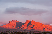 A brilliant sunrise makes the mountains around Las Vegas, Nevada glow