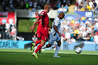 Ben Watson of Nottingham Forest battles with Andre Ayew of Swansea City during the Sky Bet Championship match between Swansea City and Nottingham Forest at the Liberty Stadium in Swansea, Wales, UK. Saturday 14 September 2019