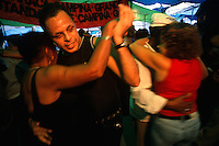 Dancers spin to forró music at the Feira Nordestina, or northeastern fair, in Rio de Janeiro's São Cristóvão neighborhood. Wares from Brazil's northeastern states, food and music kill the homesick northeasterners at the weekly fair.