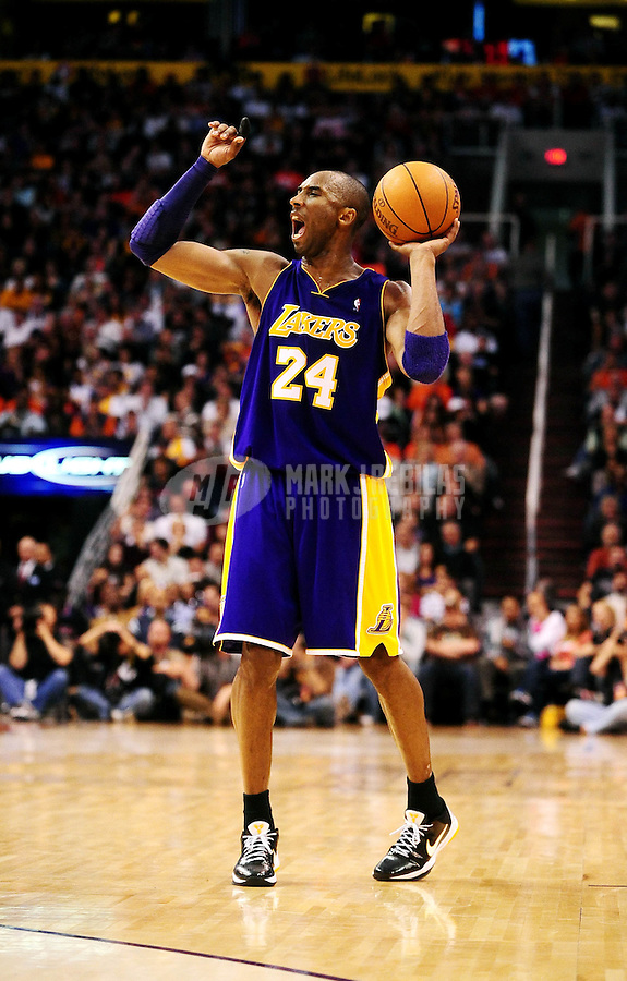 Mar. 12, 2010; Phoenix, AZ, USA; Los Angeles Lakers guard (24) Kobe Bryant calls a play against the Phoenix Suns at the US Airways Center. The Lakers defeated the Suns 102-96. Mandatory Credit: Mark J. Rebilas-