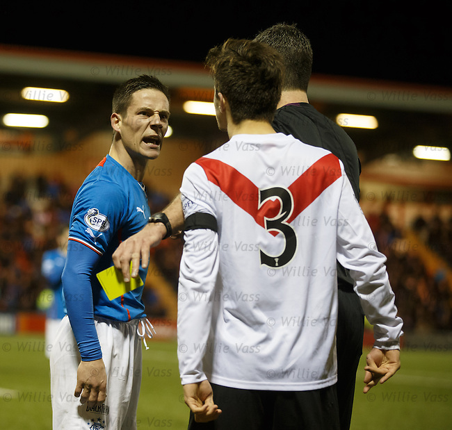 Jamie Bain exchanges plesantries with Ian Black after fouling him