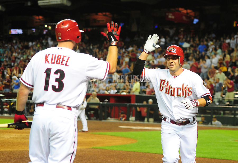 Apr. 17, 2012; Phoenix, AZ, USA; Arizona Diamondbacks shortstop John McDonald (right) celebrates with Jason Kubel after hitting a solo home run in the eighth inning against the Pittsburgh Pirates at Chase Field. The Pirates defeated the Diamondbacks 5-4. Mandatory Credit: Mark J. Rebilas-