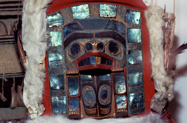 Tlingit carved wooden headdress of a bear decorated with totem motif, mountian goat fur and pieces of abalone shell