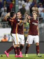 Calcio, Serie A: Frosinone vs Roma. Frosinone, stadio Comunale, 12 settembre 2015.<br /> Roma&rsquo;s Juan Iturbe, left, celebrates with teammates Radja Nainggolan, center, and Lucas Digne after scoring during the Italian Serie A football match between Frosinone and Roma at Frosinone Comunale stadium, 12 September 2015. Roma won 2-0.<br /> UPDATE IMAGES PRESS/Isabella Bonotto