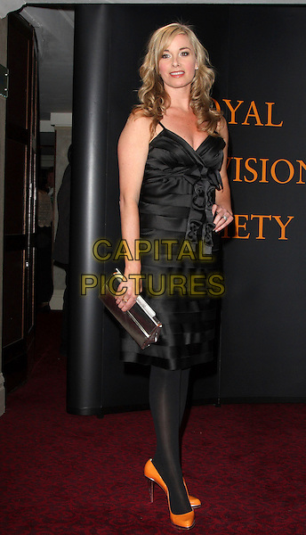 TAMZIN OUTHWAITE .Royal Television Society Awards at the Grosvenor House Hotel, Park Lane, London, England..March 17th, 2009.rts full length tamsin black dress silver clutch bag silk satin layers layered orange fluorescent shoes hand on hip neon .CAP/ROS.©Steve Ross/Capital Pictures.