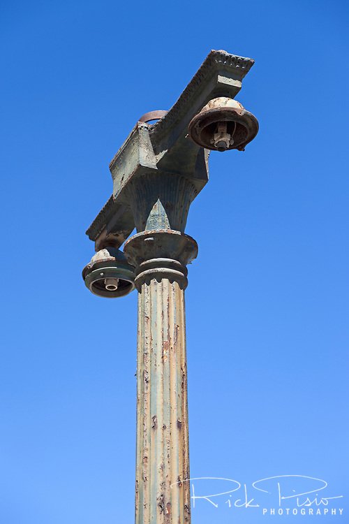 Turn of the century era street lamp outside Oakland's abandoned 16th St. train station.