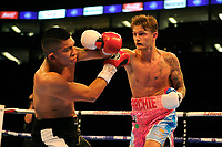 Archie Sharp (pink/white shorts) defeats Lester Cantillano during a Boxing Show at the The O2 Arena on 23rd June 2018