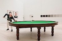 Patrick Charpenel director for the new Jumex Museum plays billiards on a table by artist Gabriel Orozco.  Mexico City