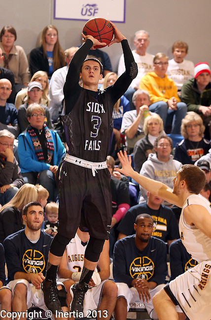SIOUX FALLS, SD - DECEMBER 7:  Mack Johnson #3 from the University of Sioux Falls spots up for a three pointer over Ben Shellim #22 from Augustana in the first half of their game Saturday evening at the Stewart Center. (Photo by Dave Eggen/Inertia)