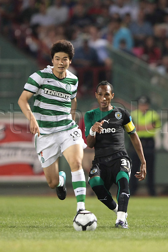 21 JUL 2010:  Celtic's Ki Sung Yueng (18) and Sporting Lisbon's Liedson (31) vie for the ball. Celtic defeated  Sporting Clube de Portugal 6-5 on penalty kicks in an international friendly match, part of the Fenway Football Challenge, at Fenway Park in Boston, Massachusetts on July 21, 2010.