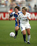 Sandra Minnert (13) pulls away from Birgit Prinz at SAS Stadium in Cary, North Carolina on 6/11/03 during a game between the Carolina Courage and Washington Freedom. Carolina won the game 3-0.