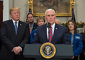 United States Vice President Mike Pence speaks before US President Donald J. Trump signs the Presidential Space Directive - 1, directing NASA to return to the moon, alongside President Donald Trump, left, Acting NASA Administrator Robert Lightfoot, second left, NASA astronaut Peggy Whitson, third from left, NASA astronaut Christina Koch, right, and members of the Senate, Congress, and commercial space companies in the Roosevelt Room of the White House in Washington, Monday, December 11, 2017. <br /> Mandatory Credit: Aubrey Gemignani / NASA via CNP