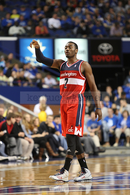 John Wall directs the offense during a stoppage of play during the NBA Preseason game between the Washington Wizards and the New Orleans Pelicans at Rupp Arena in Lexington, Ky., on Saturday, October, 19, 2013. Photo by Jonathan Krueger   Staff