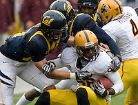 Chris Conte of California tackles T.J. Simpson of ASU during the game at Memorial Stadium in Berkeley, California on October 23rd, 2010.  California defeated Arizona State, 50-17.