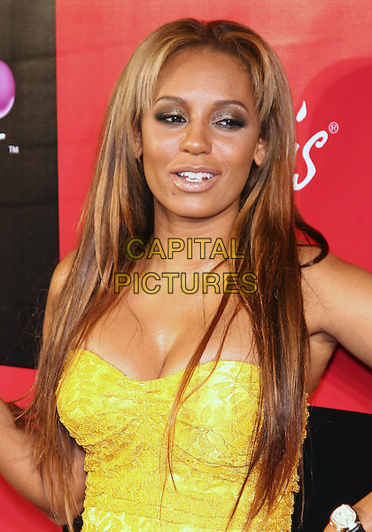 MELANIE BROWN (MEL B).Grand Opening of the Sugar Factory American Brasserie at Paris Las Vegas,  Las Vegas, Nevada, USA, .4th March 2011..portrait headshot mouth open cleavage  strapless yellow .CAP/ADM/MJT.© MJT/AdMedia/Capital Pictures.