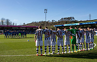 Players from both teams observe a minutes silence as a mark of respect to those who have lost their lives or were injured in the tragic attacks in Westminster London on the 22nd March 2017 during the Sky Bet League 2 match between Wycombe Wanderers and Notts County at Adams Park, High Wycombe, England on the 25th March 2017. Photo by Liam McAvoy.