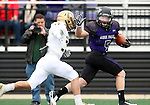 SIOUX FALLS, SD - OCTOBER 18: Brady Rose #5 from the University of Sioux Falls prepares to stiff-arm defensive playe from Southwest Minnesota State in the first half of their game Saturday afternoon at Bob Young Field in Sioux Falls. (Photo by Dave Eggen/Inertia)