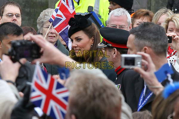 Catherine, Duchess of Cambridge (Kate Middleton).Accompanies the Royal family during  their visit to Leicester, on first date of Queen Elizabeth II's Diamond Jubilee tour of the UK, England, UK, .March 8th 2012..portrait headshot flags hats patriotic flags  union jack princess black hat green make-up eyeliner .CAP/HIL.©John Hillcoat/Capital Pictures.