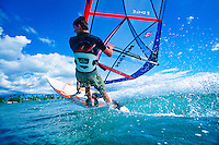 Windsurfer (Model Released) off the coast of Maui, Hawaii, USA.