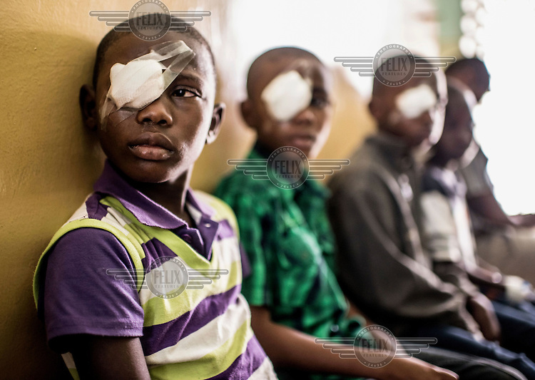 Issa Othman Hamisi, 10, waits to have his bandage removed following eye surgery at the Mnazi Mmoja hospital.