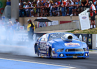 Jul. 18, 2014; Morrison, CO, USA; NHRA pro stock driver Larry Morgan during qualifying for the Mile High Nationals at Bandimere Speedway. Mandatory Credit: Mark J. Rebilas-
