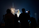 Photographers watch as the Space Shuttle  Discovery is revealed on the eve of its launch  for the final time on February 24, 2011 at Kennedy Space Center.  Discovery's mission takes it to the International Space Station (ISS) to deliver the PMM module and Robonaut 2.