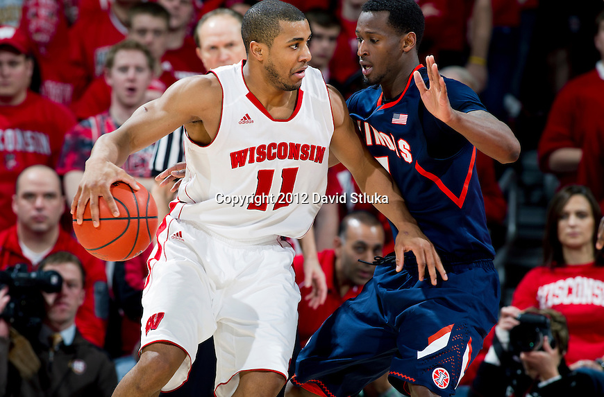 Illinois Fighting Illini guard D.J. Richardson (1) defends against Wisconsin Badgers guard Jordan Taylor (11) during a Big Ten Conference NCAA college basketball game on Sunday, March 4, 2012 in Madison, Wisconsin. The Badgers won 70-56. (Photo by David Stluka)