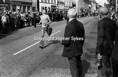 Egremont Crabapple Fair, Egremont, Cumbria England 1975. The Blue Bell 100 yards sprint down Egremont Main Street. The Blue Bell is the name of a local pub.