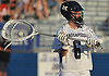 Mike Venezia #6, Massapequa goalie, looks to make a pass after making a save in the Nassau County varsity boys lacrosse Class A semifinals against Port Washington at Shuart Stadium, located on the campus Hofstra University in Hempstead, on Thursday, May 24, 2018. Massapequa scored six unanswered goals in the fourth quarter to win by a score of 11-3.