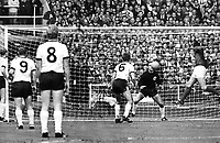 30.07.1966. Wembley Stadium, London, England. German goalkeeper Hans Tilkowski is beaten by a header from English forward Geoff Hurst (right). German players Wolfgan Weber (#6), Willi Schulz (left), Uwe Seeler (#9) and Helmut Haller (#8) can only watch in disbelief from a distance. Hurst scores the equalizer to make the score 1:1 in the World Cup final between England and Germany at London's Wembley Stadium. England went on to win their first ever World Cup with a 4:2 victory in extra time.