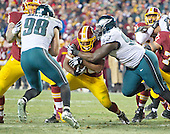Washington Redskins running back Alfred Morris (46) is tackled by Philadelphia Eagle defensive tackle Bennie Logan (96) in late fourth quarter action at FedEx Field in Landover, Maryland on Saturday, December 20, 2014.  The Redskins won the game 27 - 24.<br /> Credit: Ron Sachs / CNP