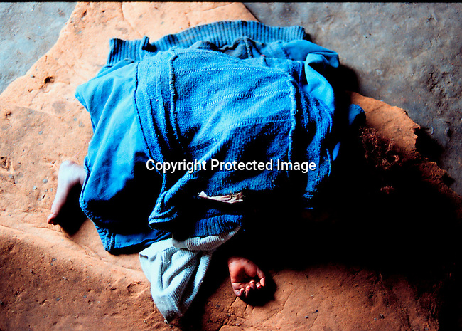 disiaids00307.  Social Issues, Health, Aids. An Aids infected baby sleeping on a broken matress in the family one-roomed house in Nbeni, Natal South Africa. Nov-99. Poverty. .©Per-Anders Pettersson/iAfrika Photos