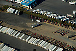 Aerial view Shipping containers at port lined up to be loaded onto truck